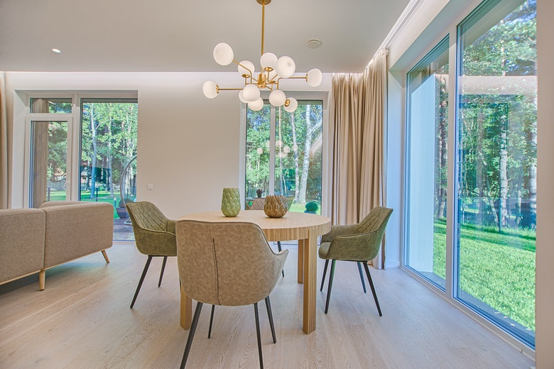 round-brown-wooden-5-piece-dining-set-in-room-1571463